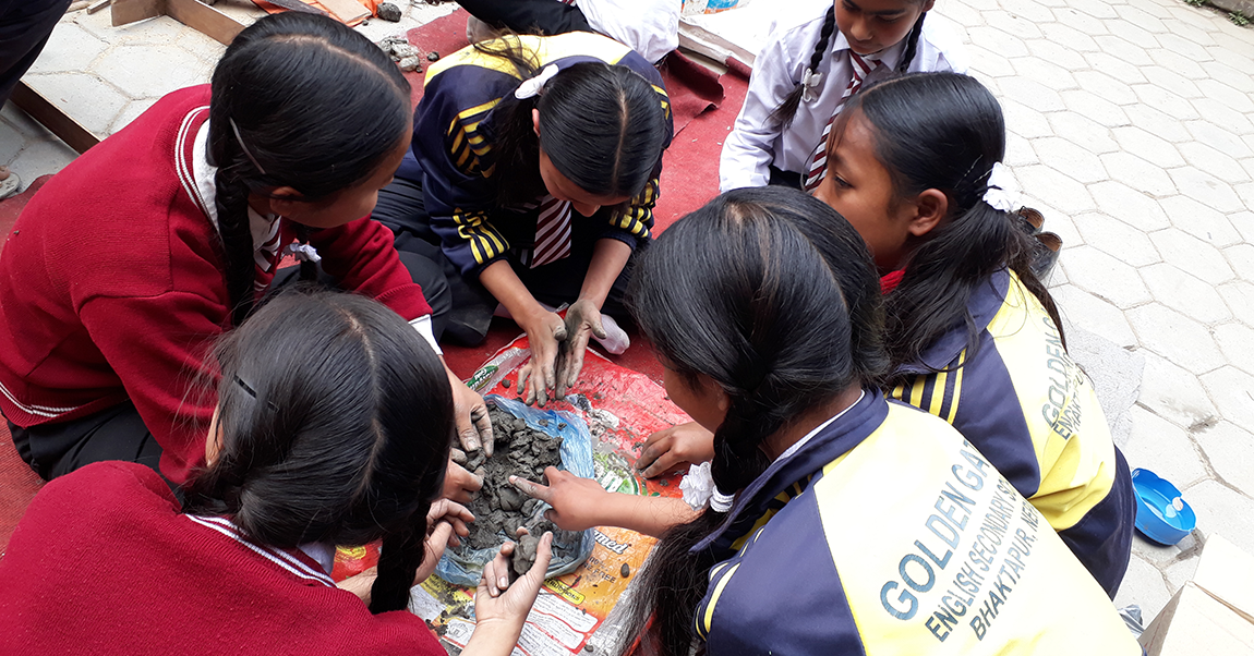 Students from Nepal working on a project