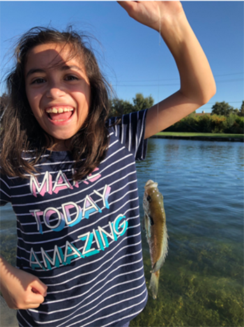 Girl showing that she caught a fish