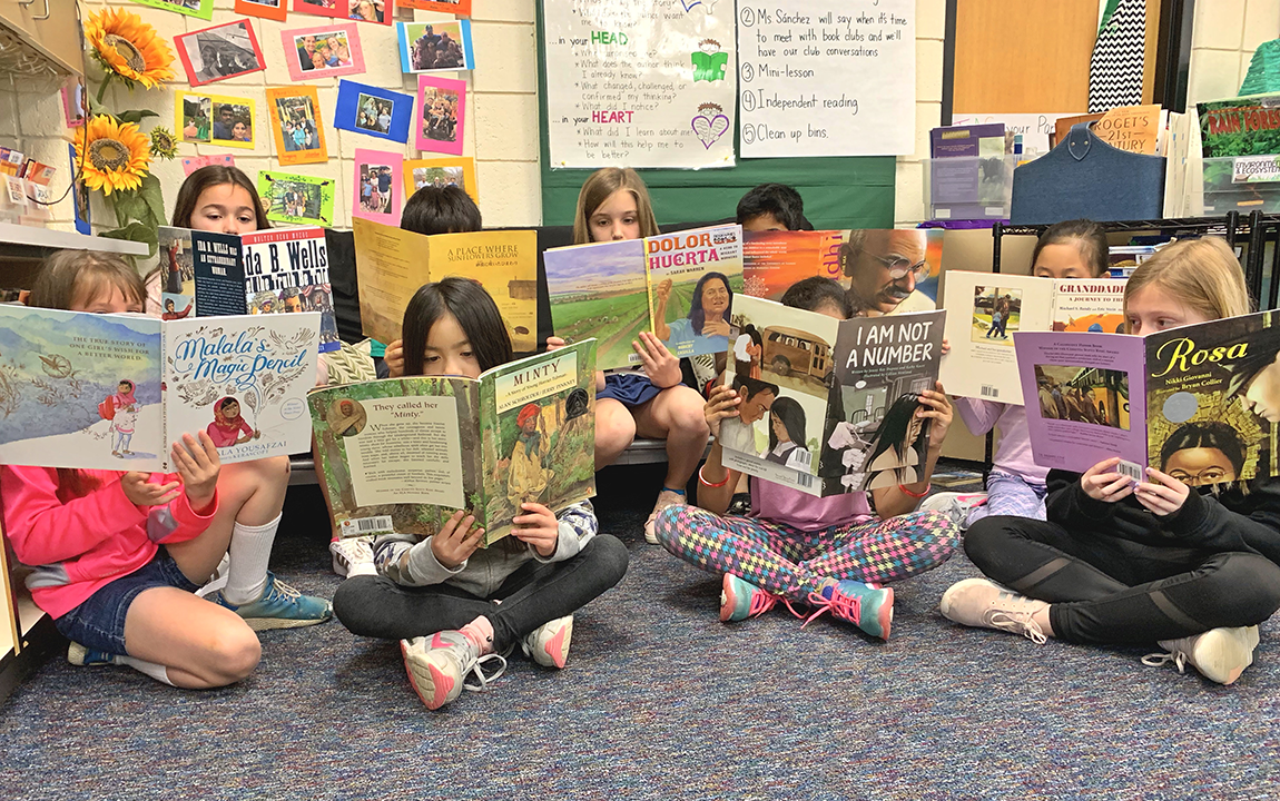 students in a PBL classroom reading