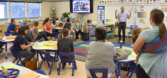 parents in a student classroom Jumping In and learning more