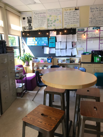 View of a classroom. Tall desk, short desk, sofa