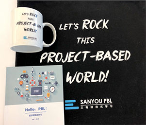 "poster and mug of the ""Let's Rock this Project-Based World!"" in China by Sanyou PBL"