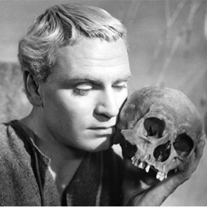 black and white photo of Hamlet holding a skull to his cheek