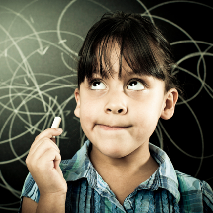 a student in front of a chalkboard with a piece of chalk in her hand.  She is looking up and look to be thinking or remembering