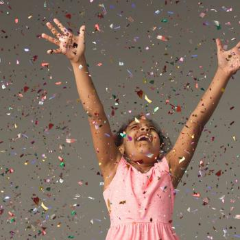 child with confetti
