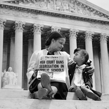 Nettie Hunt and her daughter Nickie sit on steps of the US Supreme Court building on May 18, 1954, the day following the Court's historic decision in Brown v. Board of Education