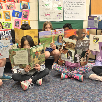 kids in a PBL classroom reading